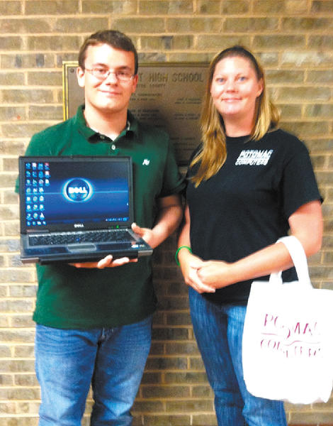 Brandon L. Barnhart holds the laptop computer he won from Potomac Computers as the store's office manager, Alle Hernandez, looks on.
