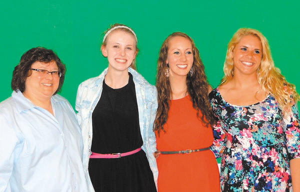 From left, Washington County Teachers Association Scholarship Chairwoman Aline Novak, Siena Lund, Emily Irwin and Haley Caudell.