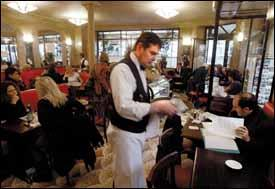 Business bustles at the Cafe de Flore, one of the main haunts of the literary set in Paris.
