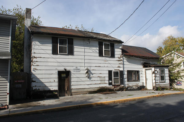 This house was ordered to be razed by the city of Charles Town in March. The Charles Town City Council recently passed a tougher set of rules that can force owners of vacant and uninhabitable properties to repair them or tear them down.