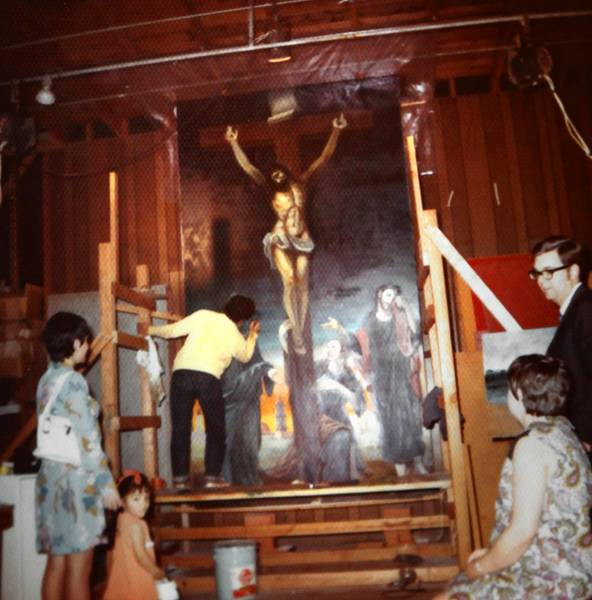 A young William Maldonado, in yellow sweater, works on the replica painting at Serra Chapel at Mission San Juan Capistrano.