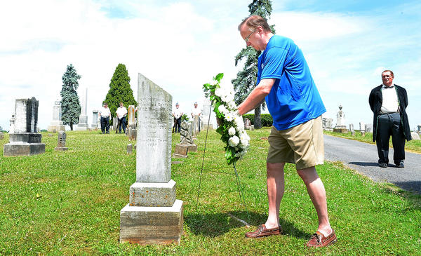 Michael Chapline, of Ft. Worth, Texas, lays a wreath at the gravesite Joseph Chapline, who was the founder of Sharpsburg in 1763. Decendants and their families of the Sharpsburg founder, gathered at Mountain View Cemetery for a wreath-laying cermony Sunday morning.
