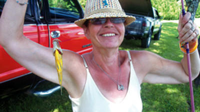"Debbi Meyers-Brant is wearing ""Heather's Hat"" on a fishing trip Saturday, her first."