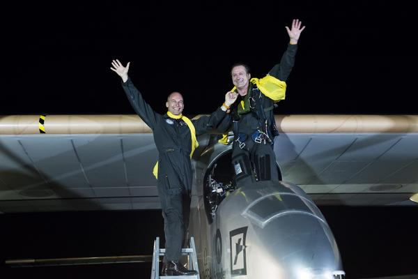 Pilot Andr Borschberg, right, and Solar Impulse project president Bertrand Piccard waving after arriving in the solar-powered airplane at John F. Kennedy International Airport in New York on Saturday after the final leg of its flight across the United States.