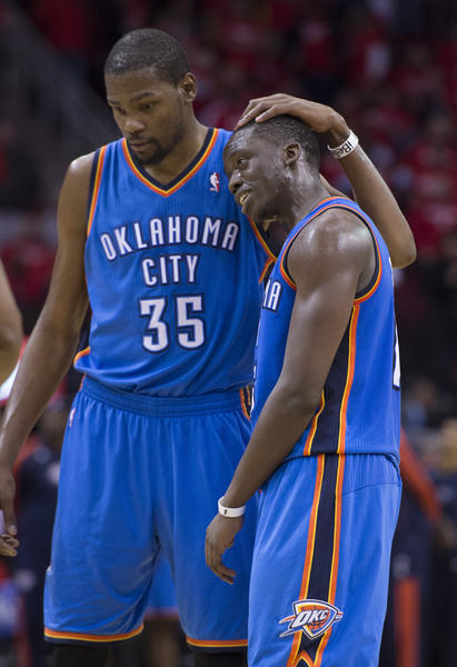 Thunder's Kevin Durant (left) and Reggie Jackson congratulate each other in the closing seconds against the Houston Rockets in the second half of their Western Conference playoff game.