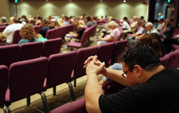 Congregants pray during services at West Valley Christian Church, where Wang Linjia and Ye Mengyuan and others had been headed to attend a church camp.