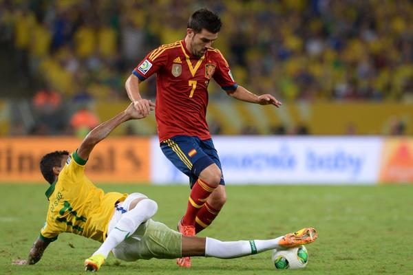 Spain's forward David Villa (R) is marked by Brazil's midfielder Luiz Gustavo during their FIFA Confederations Cup Brazil 2013 final football match, at the Maracana Stadium in Rio de Janeiro on June 30, 2013. AFP PHOTO / VANDERLEI ALMEIDAVANDERLEI ALMEIDA/AFP/Getty Images ORG XMIT: 168637465