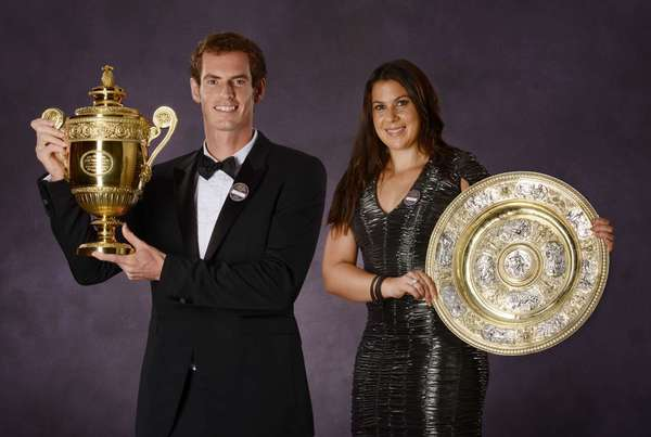 QUALITY REPEAT British tennis player Andy Murray (L) and French player Marion Bartoli pose with their 2013 Wimbledon trophies during the Wimbledon Champions Dinner in central London late on July 7, 2013, after winning their respective final matches. Murray said he is determined to push on from his stunning Wimbledon win and add further Grand Slam titles to his achievements. AFP PHOTO/POOL/BOB MARTINBOB MARTIN/AFP/Getty Images ORG XMIT: 1070