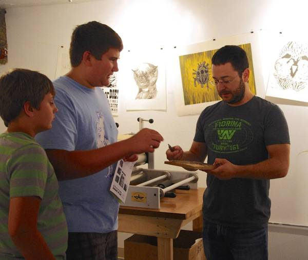 Nick and Jake Battista learned about print making from Joe Mastroianni when they visited the Water Street Studios Print Lab in St. Charles.