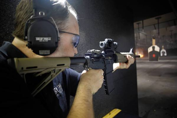 Daniel Easterday, of Highland Park, shooting his AR-15 semi-automatic rifle at the On Target Range, Sunday, June 30, 2013 in Crystal Lake. Highland Park has banned such weapons and Lake Forest is considering a similar ban.