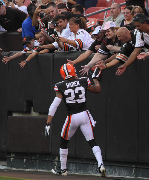 Cleveland Browns defensive back Joe Haden greets fans in the Dawg Pound before the start of the preseason game against the Philadelphia Eagles at Cleveland Browns Stadium.