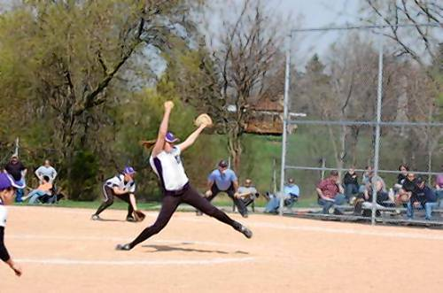 Elaine Heflin pitches for Downers Grove North last season. She will be taking her game to the University of Illinois-Chicago
