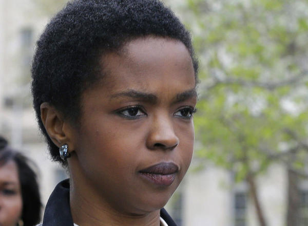 Lauryn Hill, shown in April outside a federal courthouse in Newark, N.J., has reported to prison to serve a three-month term for tax evasion.