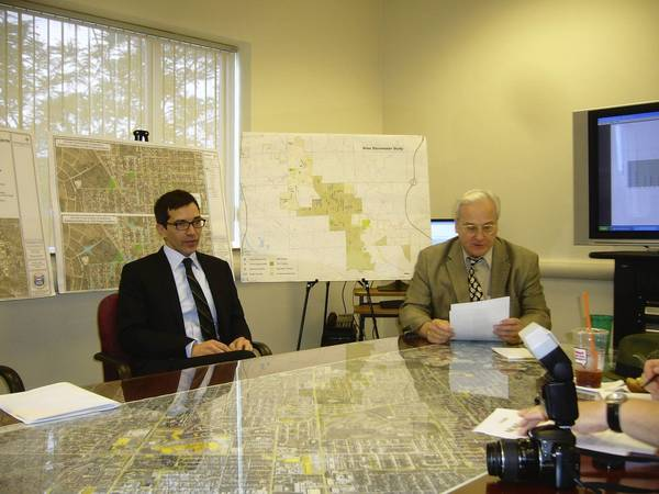 Niles Mayor Andrew Przybylo, right, and Village Manager Steve Vinezeano talk about plans to accelerate the village's stormwater relief program.