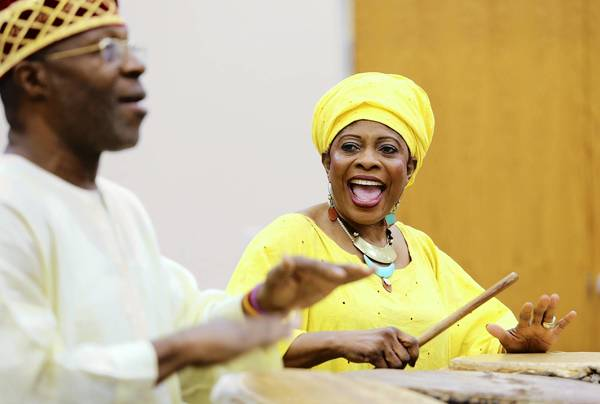 Don Harrell and his wife Tutu perform an African folklore program for children at the Leesburg public library.