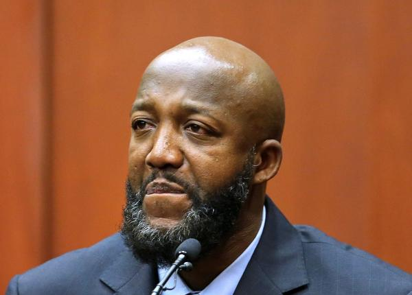Tracy Martin, the father of Trayvon Martin, pauses while testifying in George Zimmerman's murder trial at Seminole Circuit Court in Sanford, Fla.