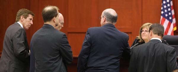 Lawyers confer with Judge Debra S. Nelson in the George Zimmerman murder trial in Sanford, Fla.