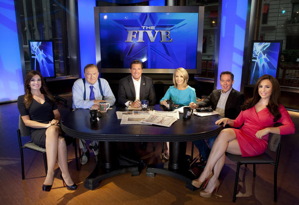 "This July photo shows the co-hosts of Fox News Channel's popular ""The Five"" -- Kimberly Guilfoyle, Bob Beckel, Eric Bolling, Dana Perino, Greg Gutfeld and Andrea Tantaros -- following a taping of the show in New York. A Gallup poll said Americans are most likely to turn to their TV news."