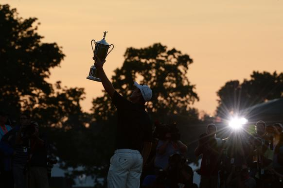 Justin Rose holds the winner's trophy aloft during the U.S. Open awards ceremony at Merion Golf Club on Sunday in Ardmore, Pa. It was the Englishman's first major victory.