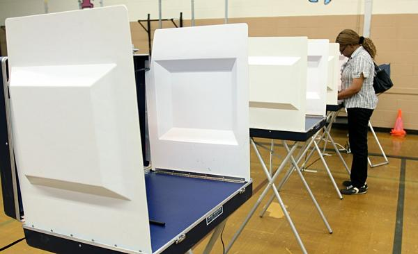 Area polls are open Tuesday. Registrars expect a moderate turnout.
