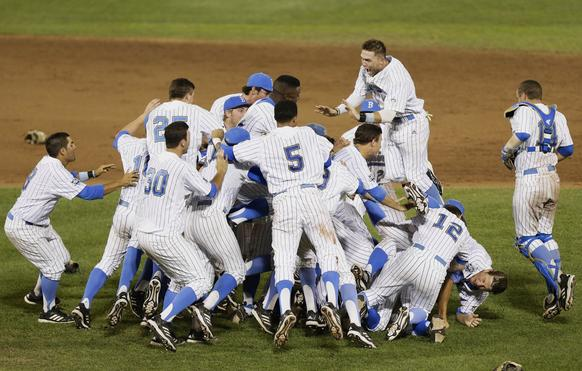 The Bruins celebrate their first NCAA baseball title at the College World Series on Tuesday.