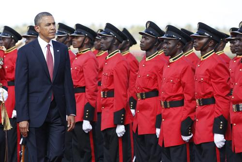 U.S. President Obama inspects a Tanzanian military honor guard during an official arrival ceremony at Julius Nyerere Airport in Dar es Salaam.