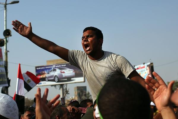 Supporters of ousted Egyptian President Mohamed Morsi rally in Cairo, Egypt, where more than 50 people were purported to have been killed by members of the Egyptian military and police. The country is in a state of political paralysis following the ousting of Morsi by the military.