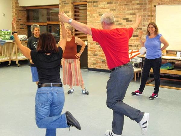 Jim Rust and Karen Rosenbluh demonstrate their folk dancing.