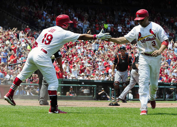 Carlos Beltran is congratulated by Jon Jay after he stole home during the third inning at Busch Stadium.
