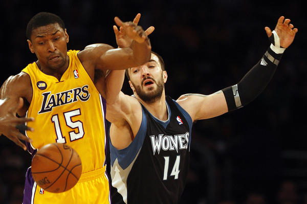 The Lakers' Metta World Peace goes for the steal on the Timberwolves' Nikola Pekovic in the first half.
