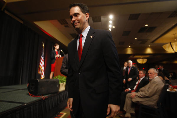Wisconsin Gov. Scott Walker signed off on abortion restrictions in a discrete manner.