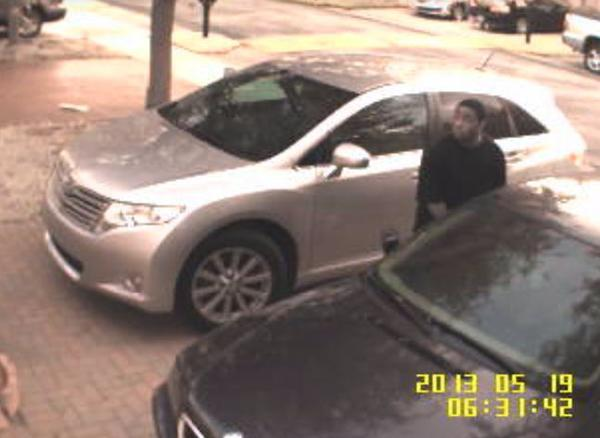 Lauderhill Police are searching for a man seen on surveillance video trying to open car doors