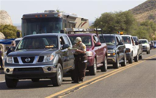 Residents of Yarnell, Ariz., show identification to return home after the deadly Yarnell Hill fire that killed 19 firefighters.