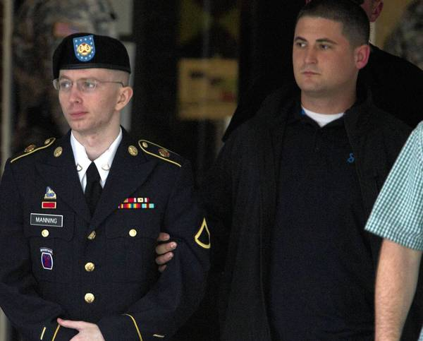 "Army Pfc. Bradley Manning, being escorted out of a courthouse Monday, ""was our best analyst by far,"" a onetime supervisor said."