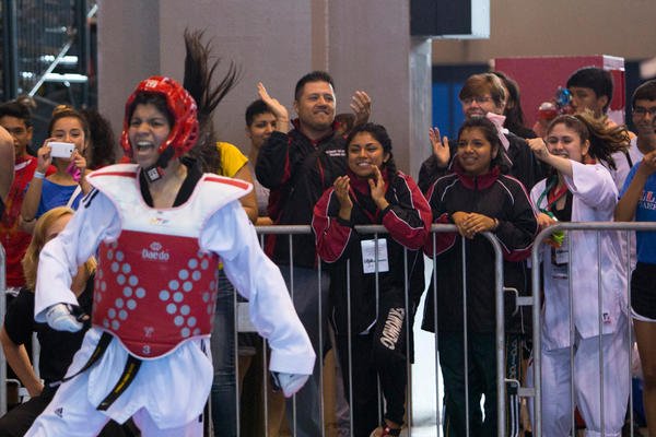 Michelle Silva, of Chicago, celebrates a victory with friends, family and teammates cheering her on at the 2013 USA Taekwondo National Championships, Monday, July 8, at McCormick Place. (Brittany Sowacke/RedEye)