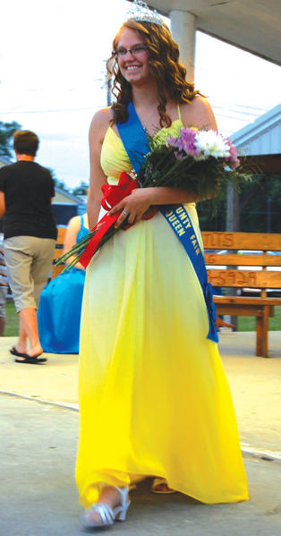 Maranda McGowan greets the crowd Monday night after she was named the 2013 Franklin County Fair Queen.