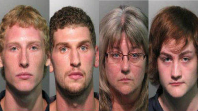 Jacob Danio, left, and Brett Megit, 24, Bobbe Barreca, 52, and Domenick Barreca, 19, were arrested at two different homes on the same street in Winter Springs after searches Monday.