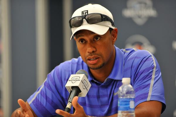 Tiger Woods, shown at a press conference last month, is favored to win the British Open.