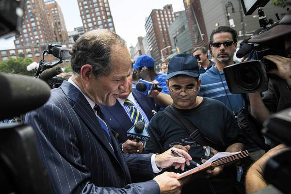 Former New York Gov. Eliot Spitzer on Sunday collects signatures from citizens to run for comptroller of New York City. Spitzer resigned as governor in 2008 after it was discovered that he was using a high-end call-girl service.