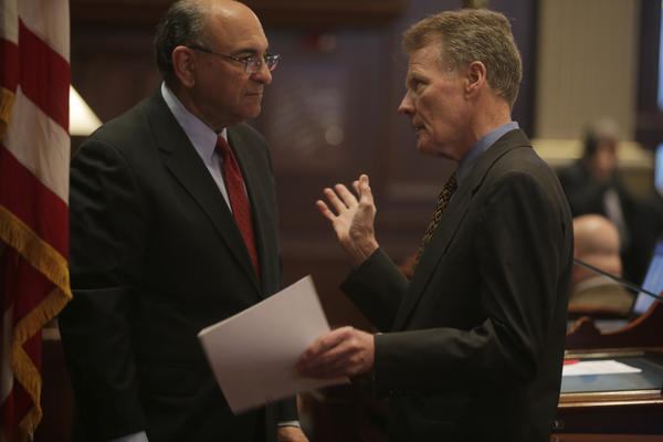 Rep. Lou Lang, D-Skokie, and House Speaker Michael Madigan confer after the House voted 77-31 to override Gov. Pat Quinn's changes to a compromise plan to regulate the concealed carrying of firearms in the state.