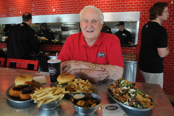 The legendary former Dolphins coach Don Shula sits at his newest restaurant Shula Burger in Delray Marketplace in Delray Beach surrounded by his favorite foods on the menu. Shula Burger is rapidly expanding throughout South Florida, another one is also slated to open soon in Kissimmee, Fla. Photo by Taimy Alvarez, Sun Sentinel