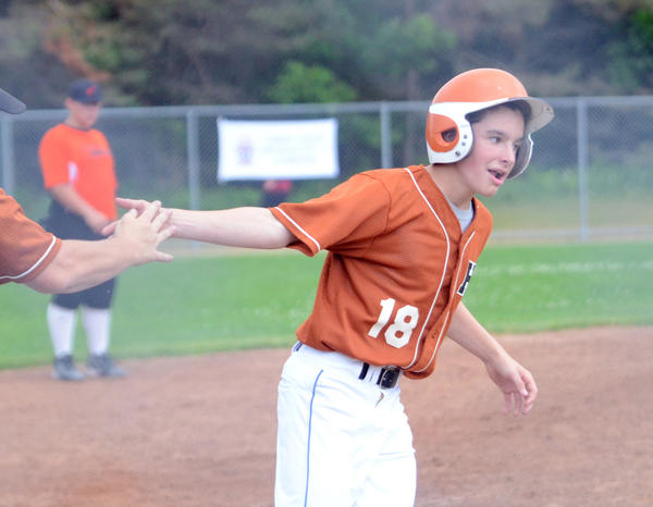 Dean Cameron of Harbor Springs gets congratulated after a third inning home run, which put Harbor Springs up 2-0 against Cheboygan during a District 13 Little League Majors Division (ages 11-12) tournament game at Bates Park.