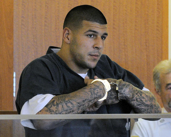 Former New England Patriots tight end Aaron Hernandez stands during a bail hearing in Fall River Superior Court Thursday, June 27, 2013 in Fall River, Mass. Hernandez, charged with murdering Odin Lloyd, a 27-year-old semi-pro football player, was denied bail.