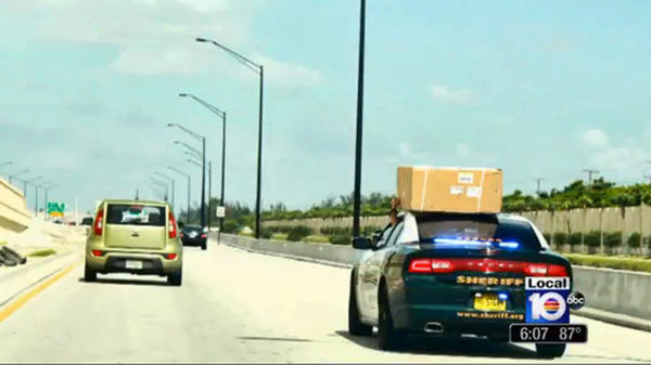 A local viewer sent this image to WPLG Local10 news that shows a BSO sergeant driving his patrol car with a box atop it without it being safely strapped in place and it seeming to be a personal item.