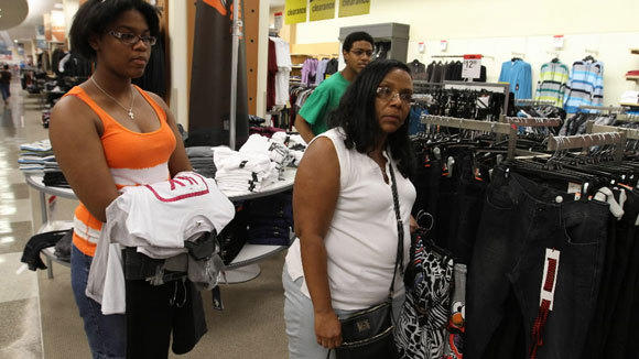 Lisa Smith takes her daughter, Kaira, and son, Joshua, shopping for school apparel at the Sears department store on State Street in a 2012 file photo.