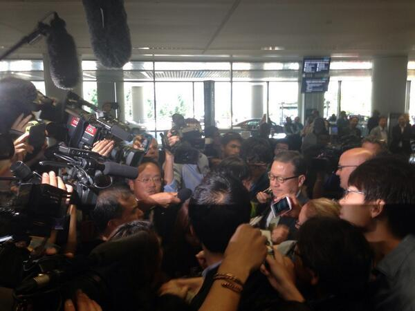 Asiana Airlines President Yoon Young-doo is swarmed by reporters upon his arrival at San Francisco International Airport.