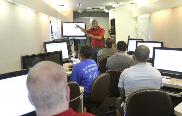 Workforce Central Florida trainer Ali Bandele teaches Excel in the Workforce bus in February.