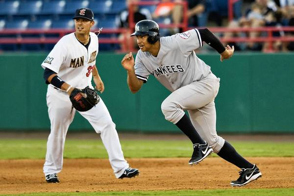 Alex Rodriguez takes off from first on a base hit while playing for the Tampa Yankees.
