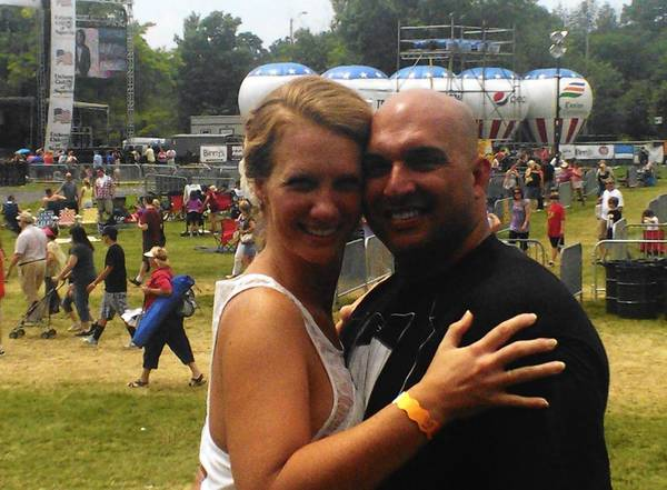 Kate and Mike Oliver held a surprise wedding reception at Ribfest in Naperville on July 6 after getting married in Spain.