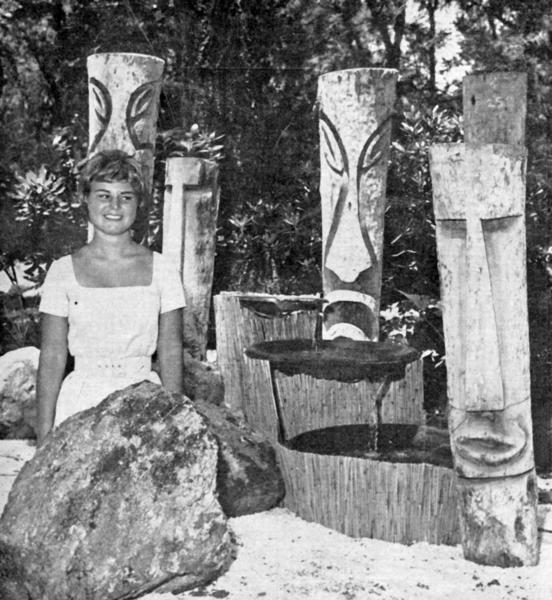 Marianne Starr of La Cañada in July 1963 posed with tiki carvings on display at the Descanso Festival of Garden Lights. Visitors were invited to visit the botanic showplace until 10 p.m. throughout the course of the festival to enjoy the night-time lighting displays.